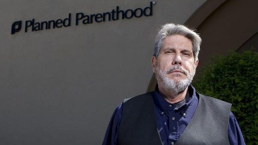 Cary Bogue, 56, a Wisconsin man who is studying to be a pastor, aimed to start a conversation about abortion and Planned Parenthood by organizing a Facebook event on Saturday called Project Wildlife. (Mark Felix/Milwaukee Journal Sentinel)