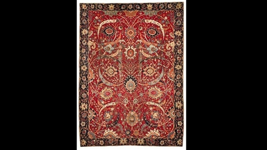 This undated file photo provided by Sotheby's shows a Sickle-Leaf Carpet, a Persian rug from Washington, D.C.s Corcoran Gallery of Art, that was auctioned in New York on June 5, 2013 by Sotheby's. Sotheby's says it sold for $33.7 million, more than three times the previous auction record for a carpet.