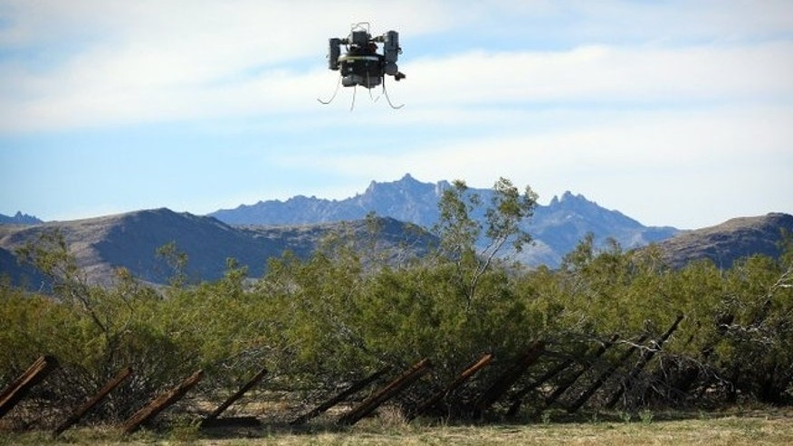 April 13, 2013: This photo shows the USGS THawk drone being used during a survey of abandoned solid waste in the Mojave Preserve.