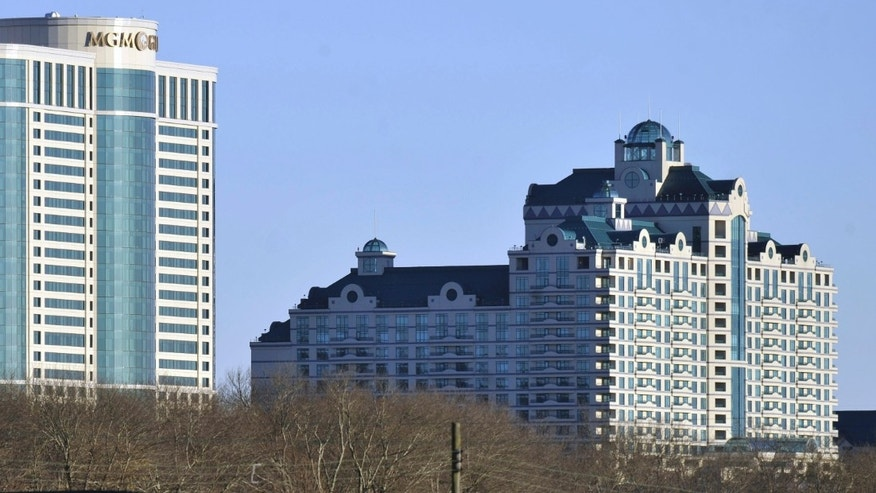 Buildings of the Foxwoods Resorts Casino rise over the landscape in Ledyard, Conn.