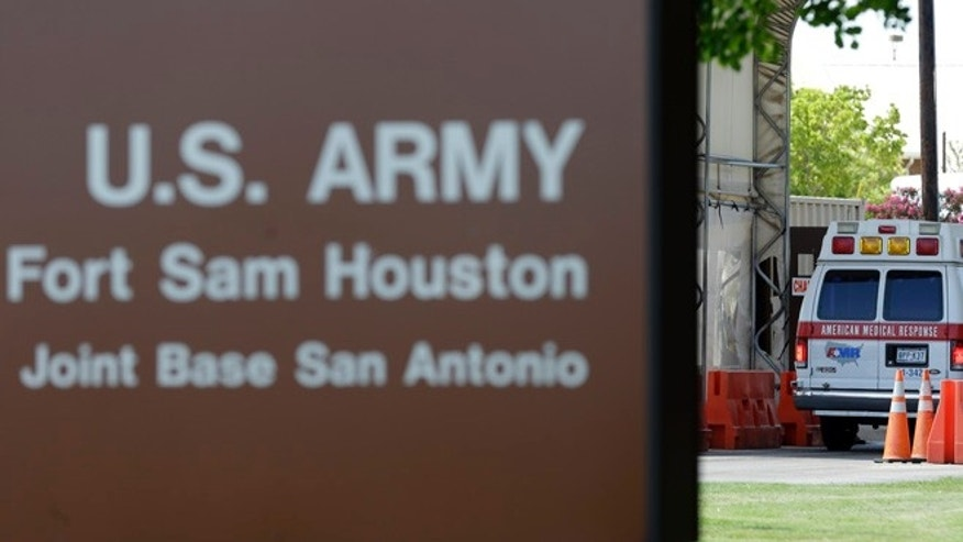 June 10, 2013: An ambulance enter at a gate to Fort Sam Houston in San Antonio.