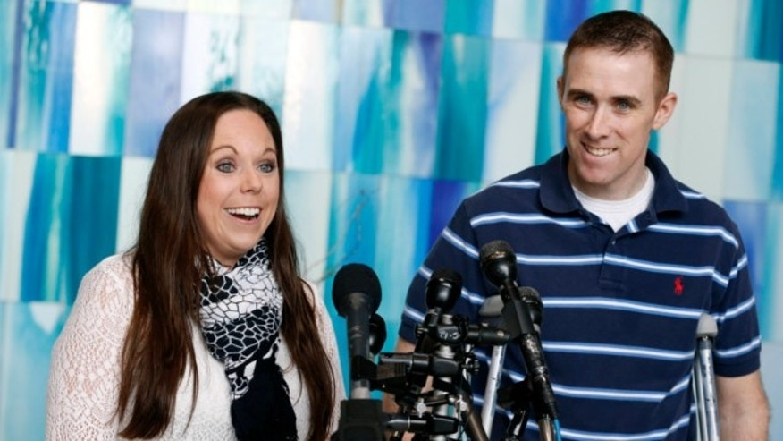 June 14, 2013: Transit police officer Richard Donohue, right, and his wife Kim speak with reporters before leaving Spaulding Rehabilitation Hospital in Boston.