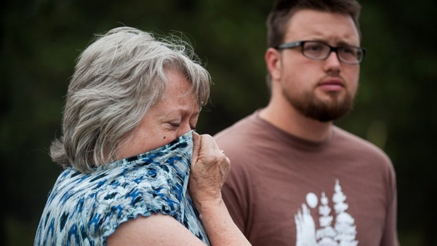 June 14, 2013: Karen Hilborn and her son Alex wait to head into the Black Forest fire burn zone with a police escort to gather items from their home near Colorado Springs, Colo.