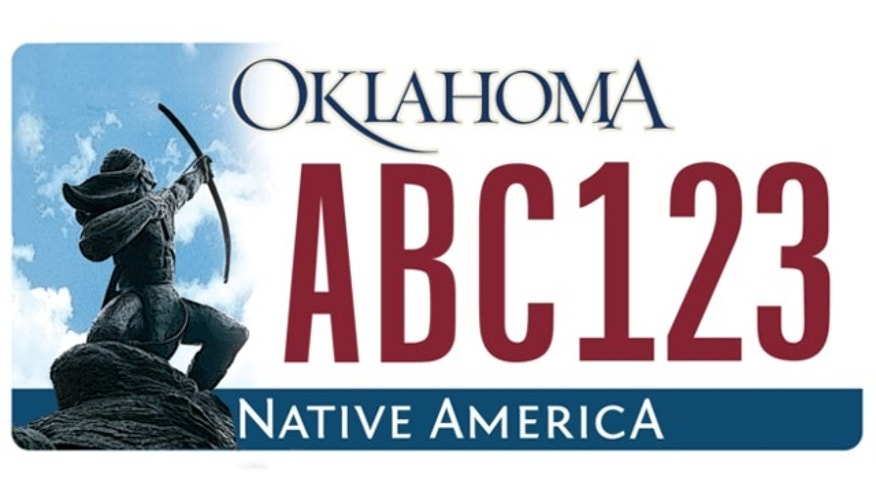 FILE: An image of a young Apache warrior is shown on a sample Oklahoma license plate.