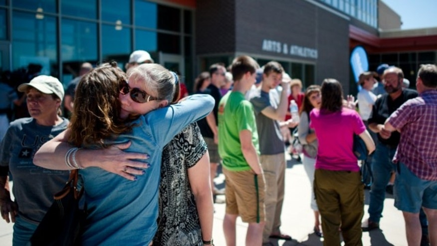 June 15, 2013: Black Forest residents hug outside a community meeting to give information regarding the Black Forest wildfire near Colorado Springs, Colo.