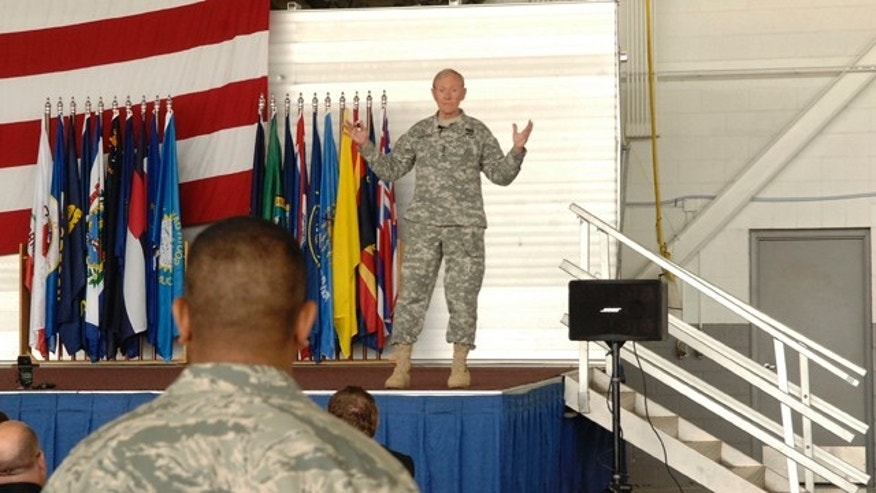 June 17, 2013: Army Gen. Martin Dempsey, the chairman of the Joint Chiefs of Staff, speaks with soldiers at Minot airforce base in Minot, N.D.