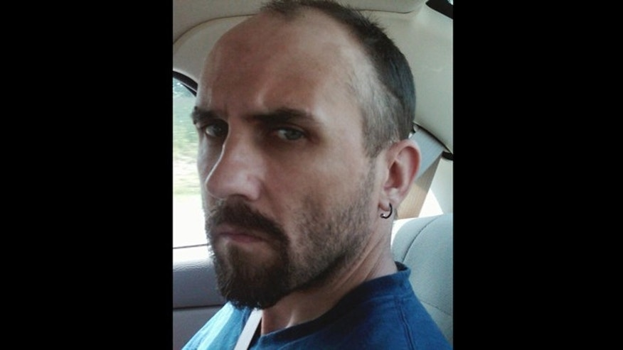 This undated photo released by the Department of Justice shows Daniel Brown. Authorities in Ohio have arrested three people, including Brown, on charges of enslaving a mentally disabled young mother and her daughter over a two-year period.