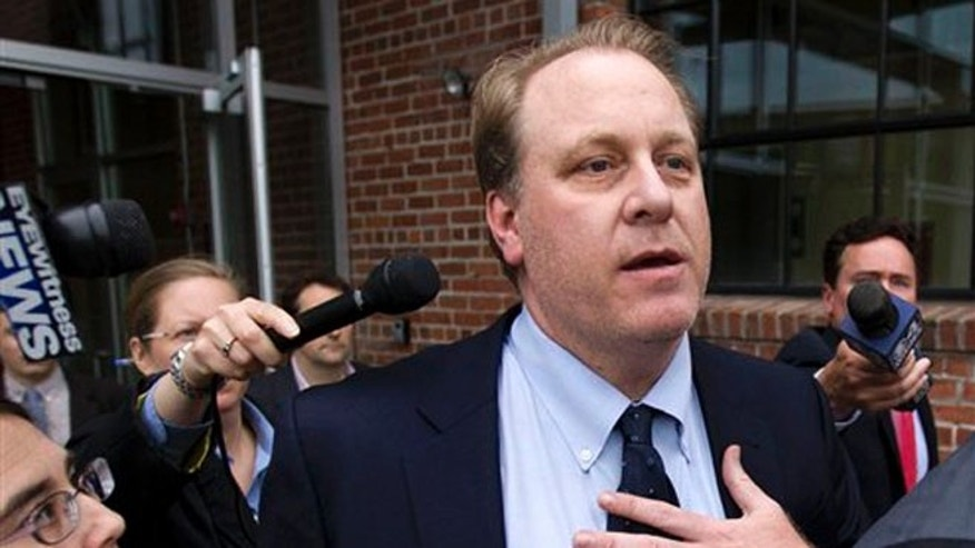 May 16, 2012: Former Boston Red Sox pitcher Curt Schilling, center, is followed by members of the media as he departs the Rhode Island Economic Development Corporation headquarters, in Providence, R.I. (AP)