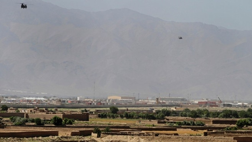 June 19, 2013: Helicopters take off from Bagram military base, 31 miles north of Kabul, in Afghanistan. (AP/Ahmad Jamshid)