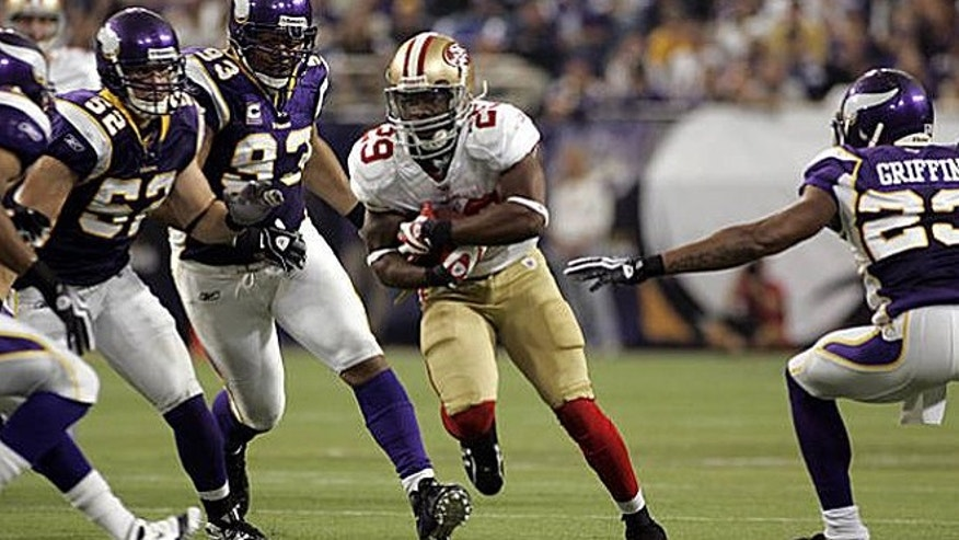 Sept. 27, 2009: San Francisco 49ers' running back Glen Coffee, center, is pursued by Minnesota Vikings' Chad Greenway (52), Kevin Williams (93) and Cedric Griffin (23) on a 21-yard run during the second half of an NFL football game in Minneapolis. Coffee is reportedly set to graduate on Friday from the U.S. Army Airborne School in Georgia. (AP)