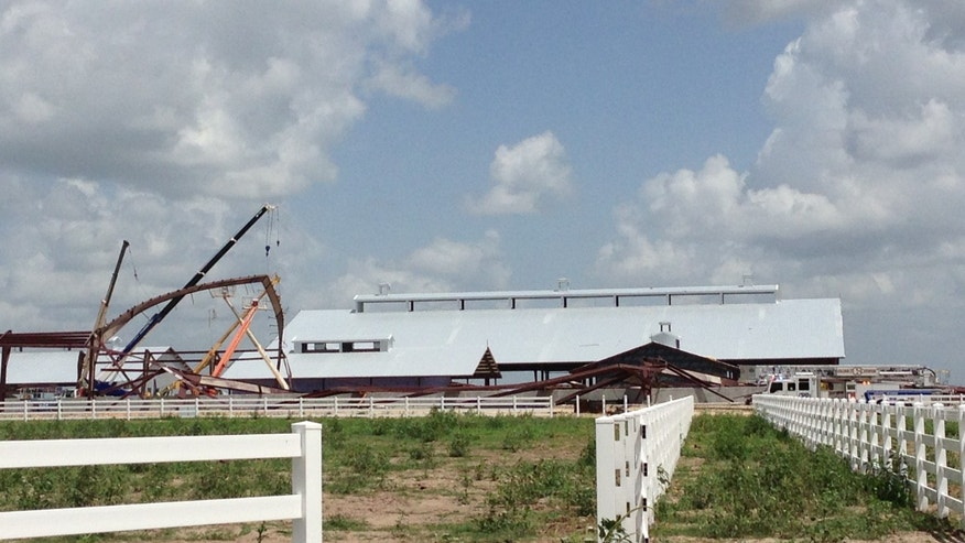 June 22, 2013: This photo provided by KBTX-TV shows damage to the Texas A&M University equestrian center near College Station, Texas.