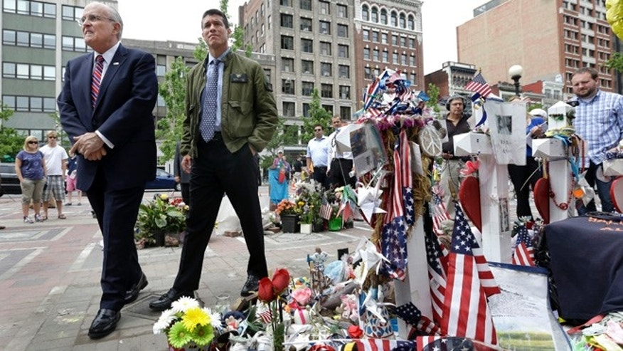 June 6, 2013: New York City Mayor Rudy Giuliani, left, walks with Gabriel Gomez, the Republican candidate for U.S. Senate in the Massachusetts open seat special election, to view the makeshift memorial for the Boston Marathon bombing victims at Copley Square in Boston.