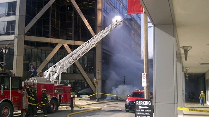 June 25, 2013: Firefighters work to put out fire at one of the largest office buildings in downtown St. Louis. The building has been evacuated afternoon after a series of explosions in the street outside. There were no reports of injuries from the explosions just before 5 p.m. Tuesday outside the One US Bank Plaza building, located across from the St. Louis Convention Center.