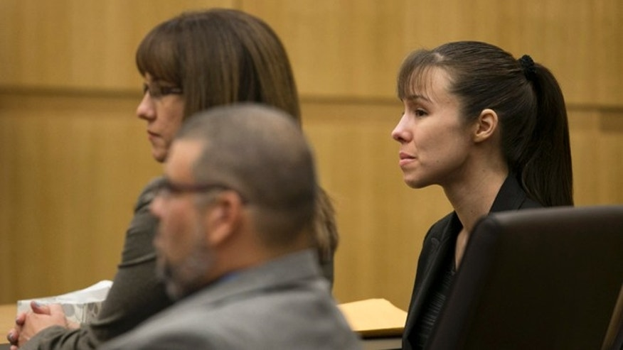 May 23, 2013: Jodi Arias listens as the verdict for sentencing is read for her first degree murder conviction at Maricopa County Superior Court in Phoenix, Ariz.