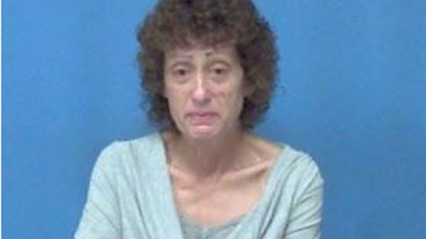 Theresa Karm, 54, of Tallmadge, has been charged with theft in office involving the Cuyahoga Falls library near Akron.