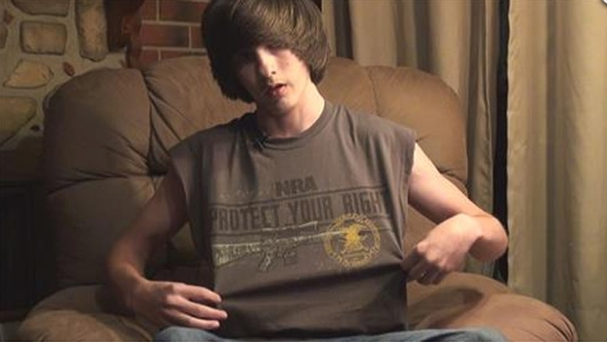 Jared Marcum, 14, returned to class wearing the same NRA T-shirt that led to his suspension and arrest after he refused a teacher's order last week to remove it.