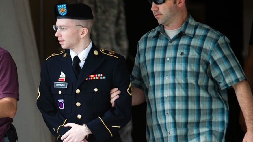 June 28, 2013: Army Pfc. Bradley Manning is escorted out of a courthouse in Fort Meade, Md., after another day of his court-martial, as he is charged with indirectly aiding the enemy by sending troves of classified material to WikiLeaks.
