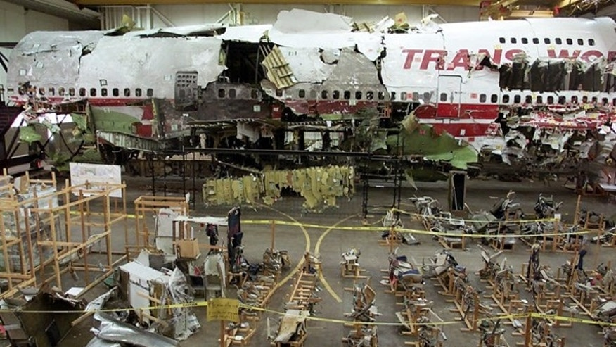 This July 16, 2001 file photo shows the seats, foreground, and the wreckage of TWA Flight 800 in a hangar in Calverton, N.Y.