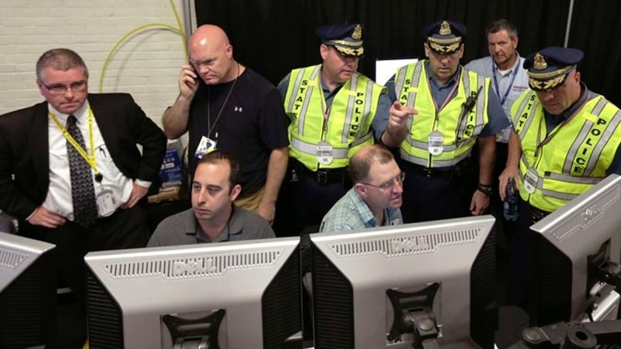 July 3, 2013: Law enforcement officials monitor surveillance cameras as part of an increased security effort for the Independence Day celebration, the first major public gathering since the Boston Marathon bombings, at the Unified Command Center in Boston.