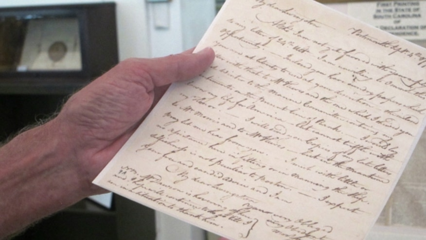 June 20, 2013: Don Campagna, a member of the Naval Order of the United States, holds a letter written in 1777 by John Paul Jones, acknowledged as the father of the U.S. Navy, at the Charleston Library Society in Charleston, S.C.