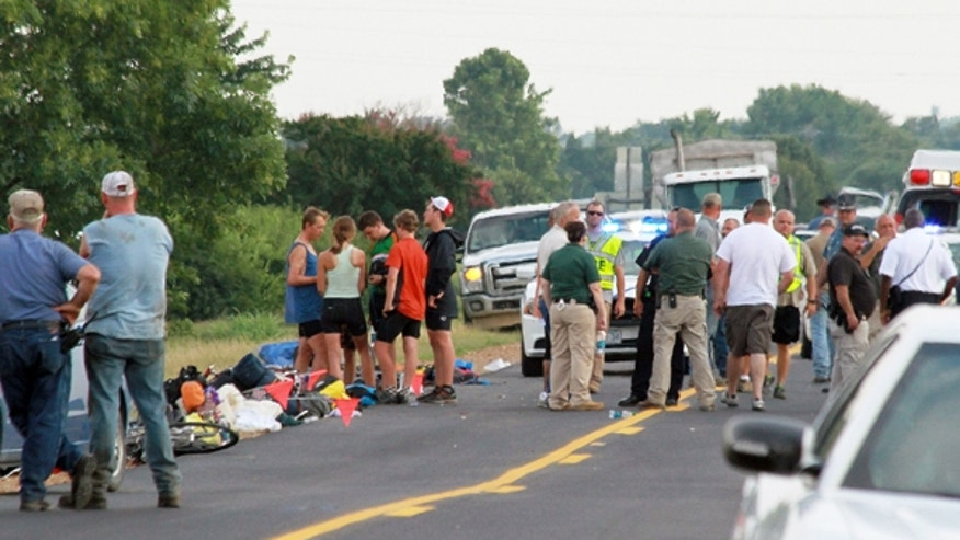 July 2, 2013: The scene of an accident in McCrory, Ark., after a car crashed into a group of bicyclists from a Massachusetts-based summer camp program on a cross-country trip, according to authorities. Police say, on Thursday, July 4, 2013, that an 18-year-old Massachusetts woman has died after she was injured in the accident.