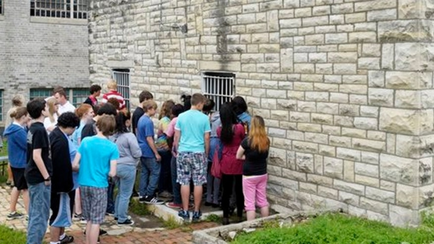 May 13, 2011: Students look through the barred windows of the gas chamber still on site at the former Missouri State Penitentiary in Jefferson City.