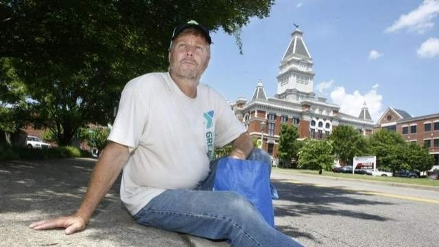 Rev. Willie Lyle rests along a curb in downtown Clarksville. The Sango United Methodist Chirch pastor went undercover living on the streets for a week. / THE LEAF-CHRONICLE/GREG WILLIAMSON