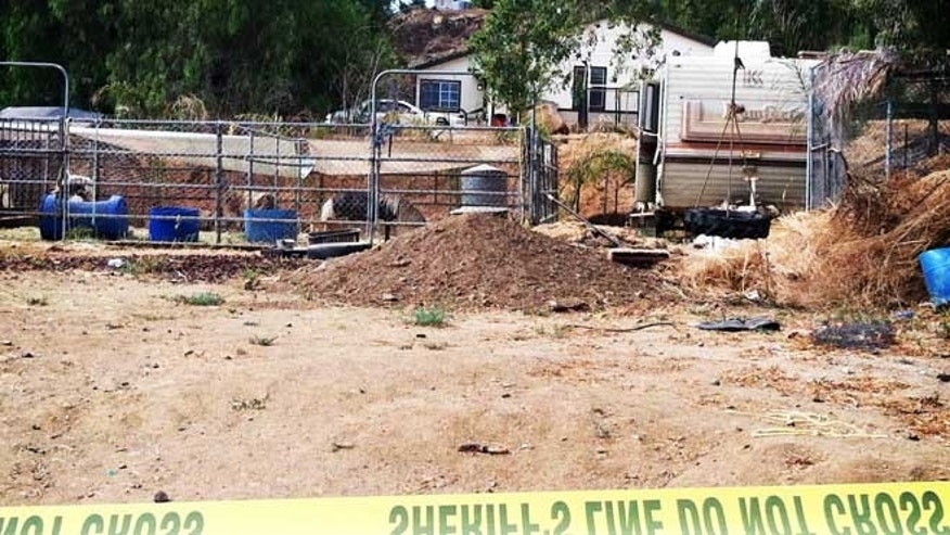 July 10, 2013: Crime scene tape cordons off an area where Riverside County Sheriff's Deputies are investigating reports of human remains in Menifee, Calif.