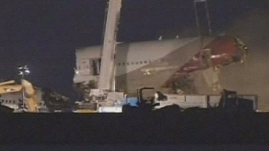 July 12, 2013: In this image from video provided by ABC7 News/KGO-TV a section of the fuselage of Asiana Flight-214 is removed at San Francisco airport early Friday morning.