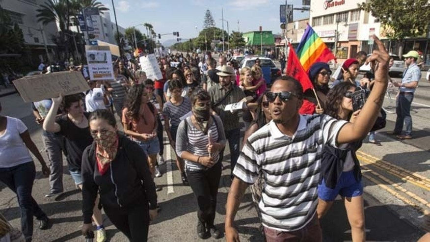 July 14, 2013: Thousands of demonstrators protest in Los Angeles the day after George Zimmerman was found not guilty in the shooting death of Trayvon Martin. (AP Photo/Ringo H.W. Chiu)