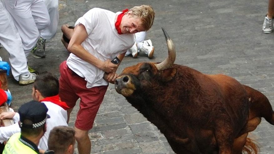 Patrick Eccles, a junior at the University of Utah, is gored by a fighting bull during the running of the bulls at the San Fermin festival.