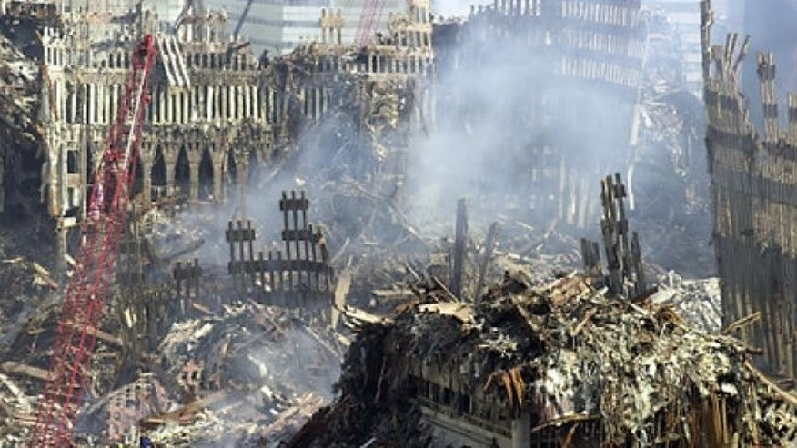 FILE: Sept. 19, 2001: Smoke rises from ground zero of the collapsed World Trade Center, more than a week after the terrorist attacks in New York.
