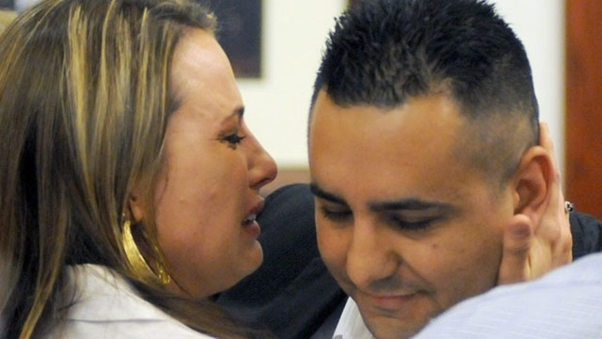 July 16, 2013: Levi Chavez, right, a former Albuquerque police officer, gets a hug from his wife, Heather Chavez, after being cleared of charges he murdered his estranged wife, Tera Chavez, in in 2007. (AP Photo/Albuquerque Journal, Adolphe Pierre-Louis)