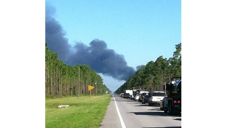 July 17, 2013: In this photo made available by Dylan Dunaway shows heavy smoke near Highway 98 near Mexico Beach, Fla., after a drone crashed on takeoff from Tyndall Air Force Base.