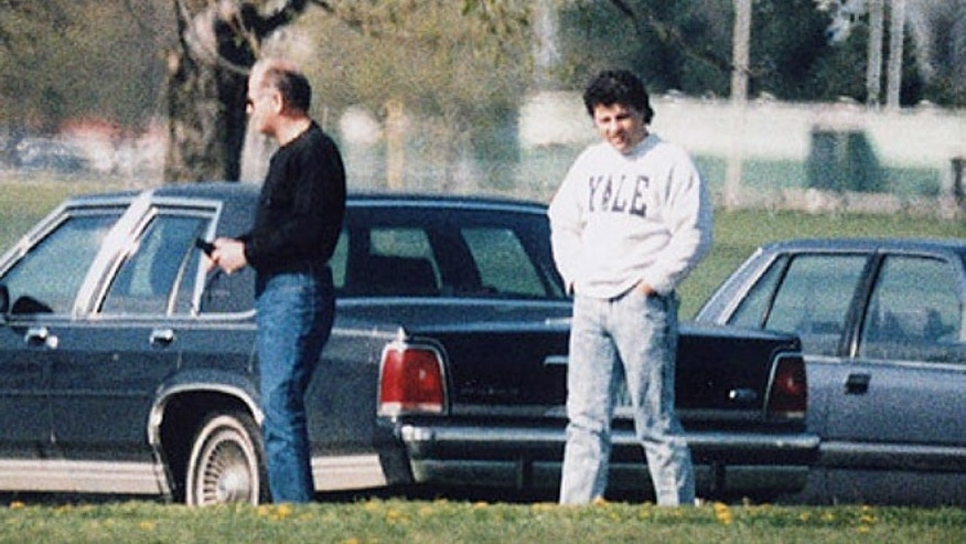 This undated surveillance photo released by the U.S. Attorney's office at federal court in Boston shows James 'Whitey' Bulger, left, with his former right hand man, Kevin Weeks.