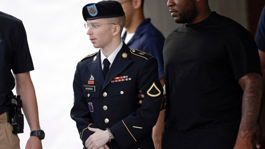 July 15, 2013: Army Pfc. Bradley Manning, center, is escorted to a waiting security vehicle outside of a courthouse in Fort Meade, Md., after appearing for a hearing at his court martial.