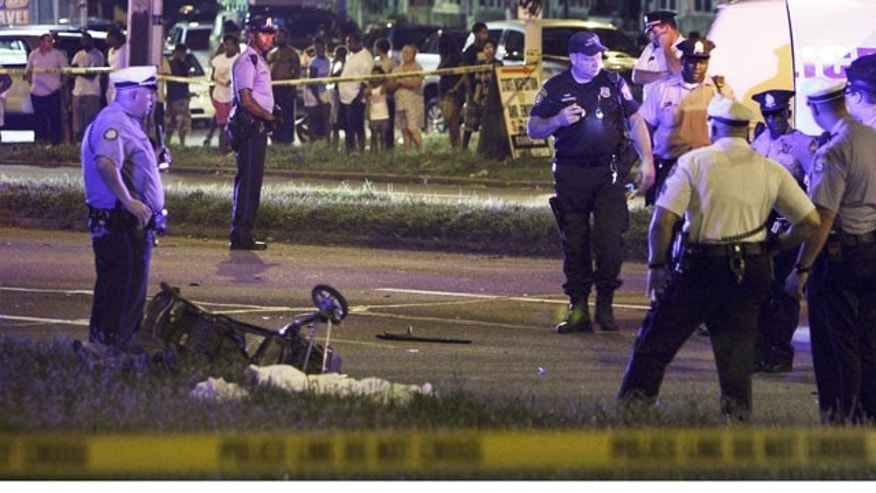 July 16, 2013: Police gather at the scene of a fatal accident on Roosevelt Boulevard in the Olney section of Philadelphia (AP Photo)