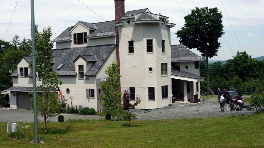 This June 18, 2007, file photo shows the home of Ed and Elaine Brown in Plainfield, N.H. Federal officials preparing to sell the New Hampshire compound of the tax-evading couple convicted of amassing an arsenal of weapons can't guarantee that explosives and other booby traps aren't hidden on the 103-acre spread.