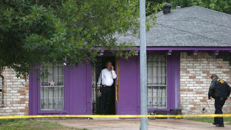 July 19, 2013: Authorities investigate a home in Houston where police say four homeless men were found in deplorable conditions.