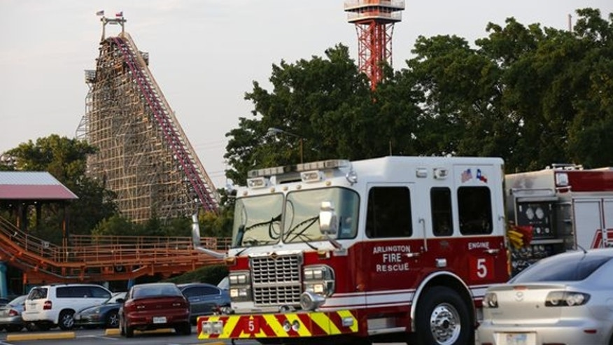 July 19, 2013: Emergency personnel are on the scene at Six Flags Over Texas in Arlington, Texas, after a woman died on the Texas Giant roller coaster.