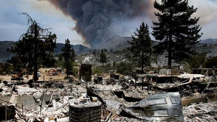 July 16, 2013: The burned remains of one of the homes on Bonita Vista Rd. near Lake Hemet, Calif., from the Mountain Fire. (AP Photo)