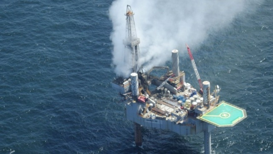July 23, 2013: This photo released by the Bureau of Safety and Environmental Enforcement shows natural gas spewing from the Hercules 265 drilling rig in the Gulf of Mexico off the coast of Louisiana.