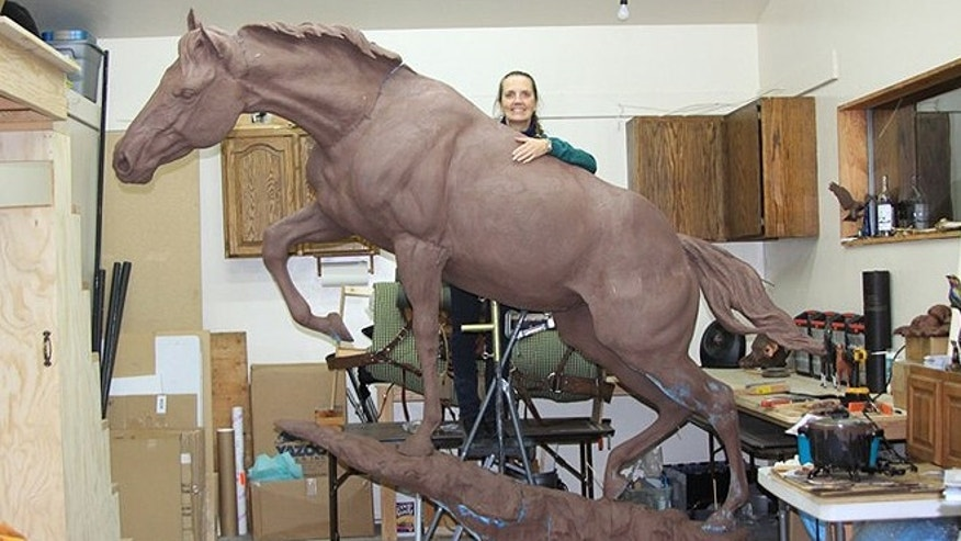 "A 10-foot bronze statue of the courageous – and insatiable – horse, Staff Sgt. Reckless, will be unveiled Friday at the Marine Corps Museum in Quantico, Va. ""She wasn't a horse, she was a Marine,"" said author Robin Hutton, whose book on the Mongolian mare is due out later this year. (SgtReckless.com)"