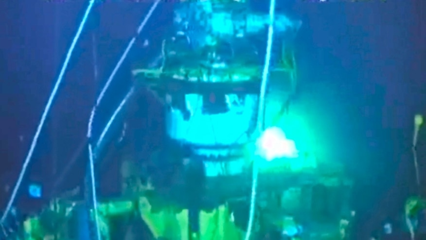 Aug. 3: In this image taken from video provided by BP PLC, the new 75-ton cap sits atop the site of the Deepwater Horizon oil spill in the Gulf of Mexico.