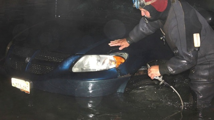 July 23, 2013: Rescue diver Travis Preston, a Jonesboro, Maine firefighter, hooks up a minivan in the water on the boat ramp at the scene of the double fatal accident in Roque Bluffs, Maine.