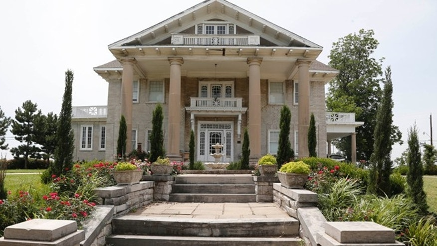 June 27, 2013: The Brady Mansion is pictured in Tulsa, Okla. The Kufdakis family, Greek and Puerto Rican immigrants, bought the grand Brady Mansion in 2009. (AP/Sue Ogrocki)