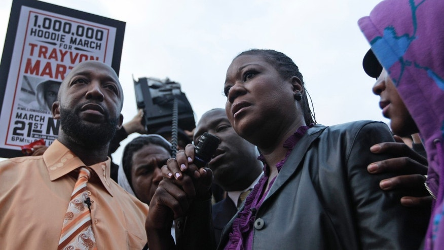 March 21, 2012: Trayvon Martin's parent's Tracy Martin, left, and Sybrina Fulton, center, take part in the Million Hoodie March in Union Square in New York. (AP/Mary Altaffer)