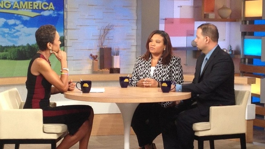 "July 25, 2013: This image released by ABC shows host Robin Roberts, left, with Juror B29 from the George Zimmerman trial, center, and attorney David Chico on ""Good Morning America,"" in New York ."