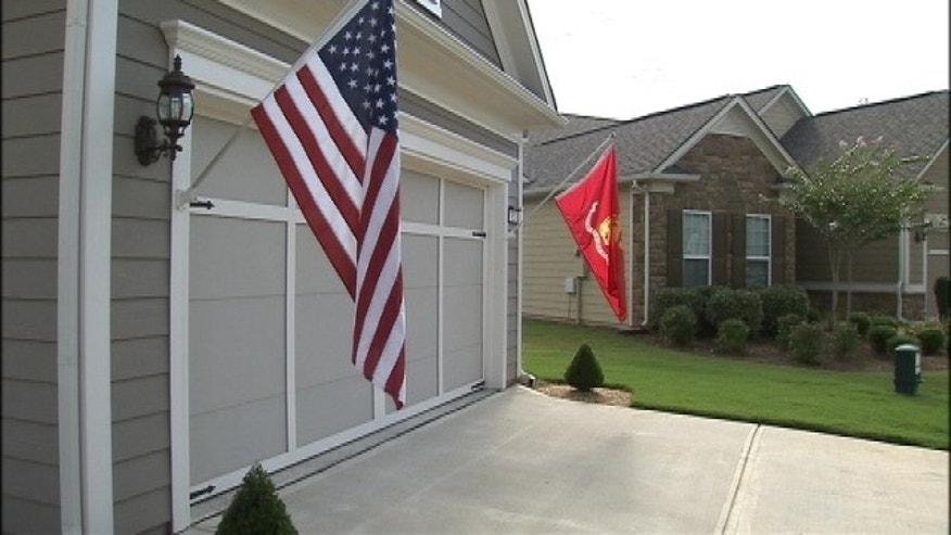 UNDATED: Marine Captain Jim Lowe has been told to take down either his American or Marine Corps flags that are displayed outside his home in an adult residential community in Griffin, Georgia.