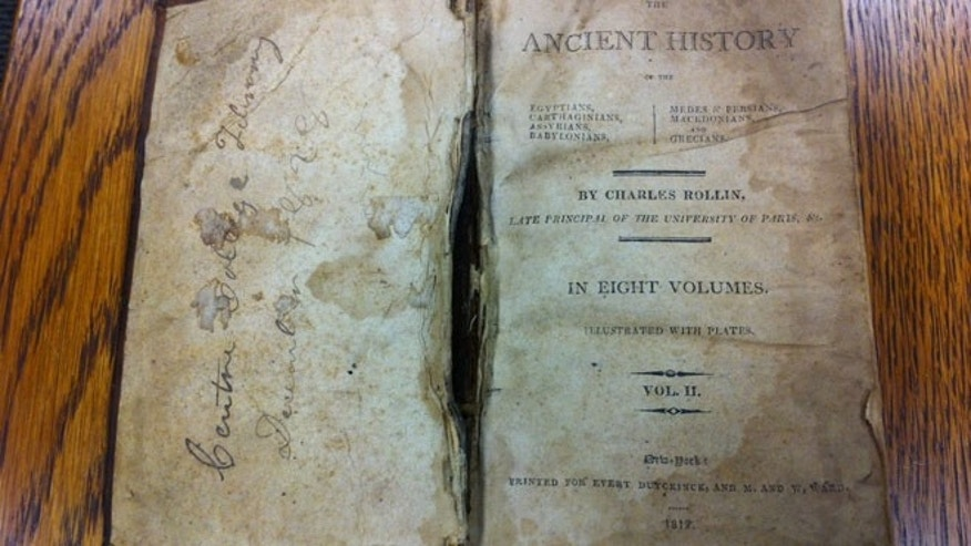 This image, provided by Centre College in Kentucky, shows the 185-year-old history book.